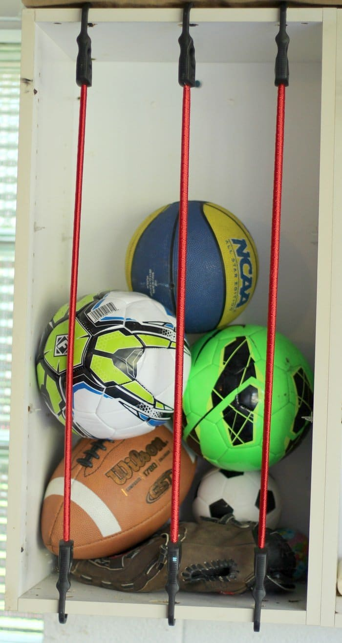 Sports Ball Garage Storage Solution With Bungee Cords