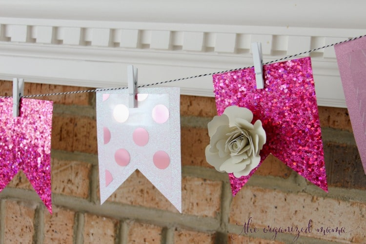 Give your home some pink for spring with these easy spring mantel decor ideas. Use the Xyron Creative Station to turn paper into stickers and add a banner to your mantel, along with adding greens and pops of pink! #floral #paperflower
