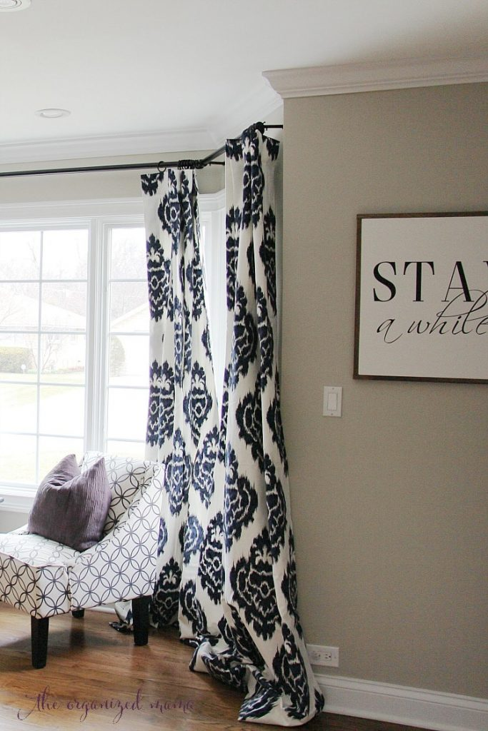 how to hang bay window curtains on an oversized window 85858